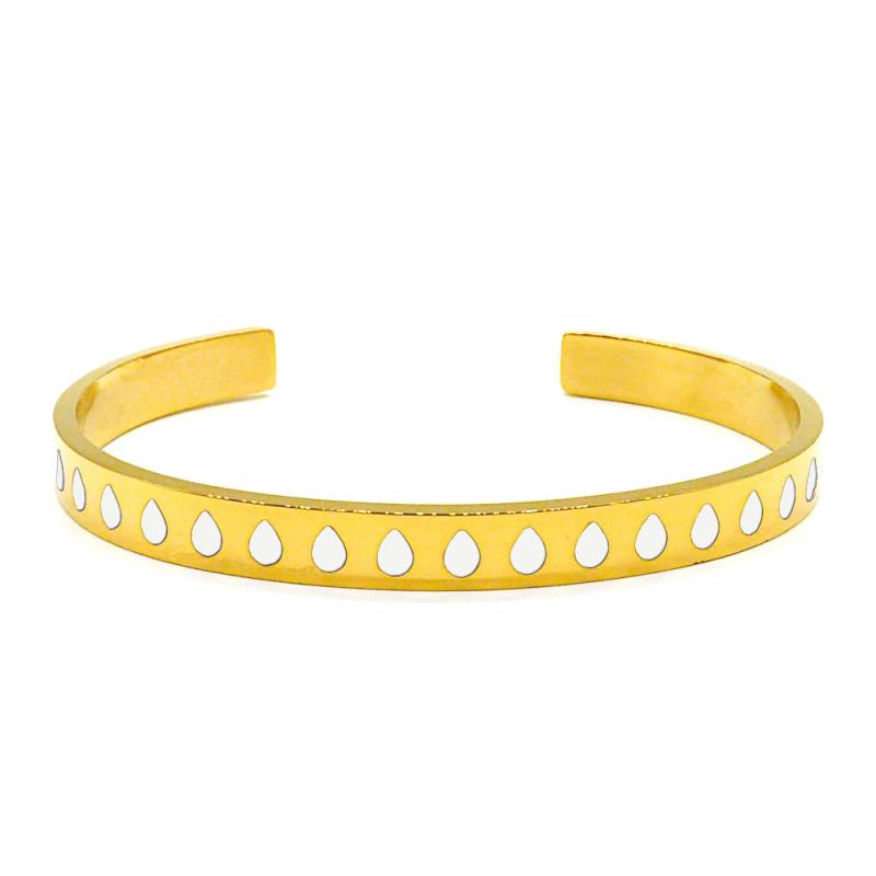 Bracelet jonc en métal doré émaillé de gouttes blanches
