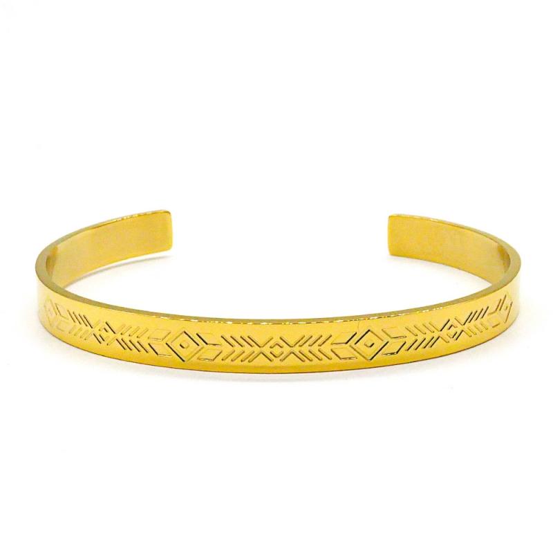Bracelet jonc en métal doré gravé de motifs ethniques